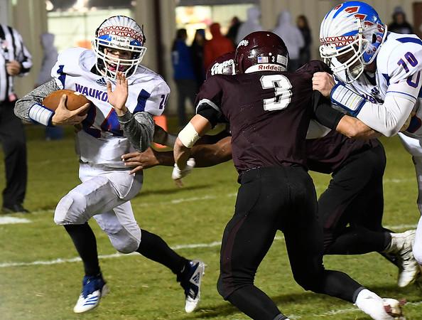 Waukomis' Devin Wagner tries to get around the corner against Pioneer Thursday October 18, 2018 at Pioneer High School. (Billy Hefton / Enid News & Eagle)