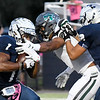 Enid's Brayan Hernadez tries to blocks Edmond Santa Fe's Trace Ford as Will Phillips carries the ball Friday October 5, 2018 at D. Bruce Selby Stadium. (Billy Hefton / Enid News & Eagle)