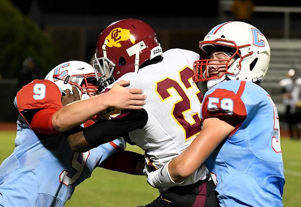 Chisholm's Rhett Weber and Lane Smith tackle Centennial's Deshawn Johnson Friday October 12, 2018 at Chisholm High School. (Billy Hefton / Enid News & Eagle)
