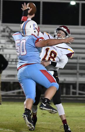 Chisholm's Cody Cross pressures Centennial's Jesse Morey Friday October 12, 2018 at Chisholm High School. (Billy Hefton / Enid News & Eagle)