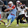 Chisholm's Lane Smith carries the ball against Centennial Friday October 12, 2018 at Chisholm High School. (Billy Hefton / Enid News & Eagle)