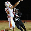 OBA's Wyatt Brooks hits Texhoma's Bode Grice Friday October 26, 2018 at OBA. (Billy Hefton / Enid News & Eagle)