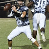 Enid's Maddux Mayberry looks for a receiver against Norman Friday October 18, 2019 at D. Bruce Selby Stadium in Enid. (Billy Hefton / Enid News & Eagle)