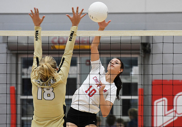 Chisholm's Raylee Savage hits the ball against Tipton's Brie Elliott during a regional tournament Thursday, October 3, 2019 at Chisholm Middle School. (Billy Hefton / Enid News & Eagle)