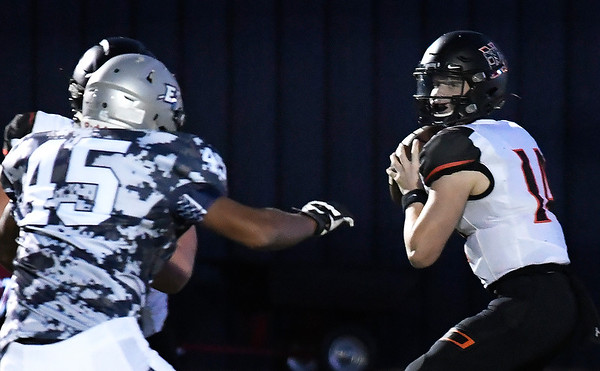 Norman's Cade Horton looks for a receiver against Enid Friday October 18, 2019 at D. Bruce Selby Stadium in Enid. (Billy Hefton / Enid News & Eagle)