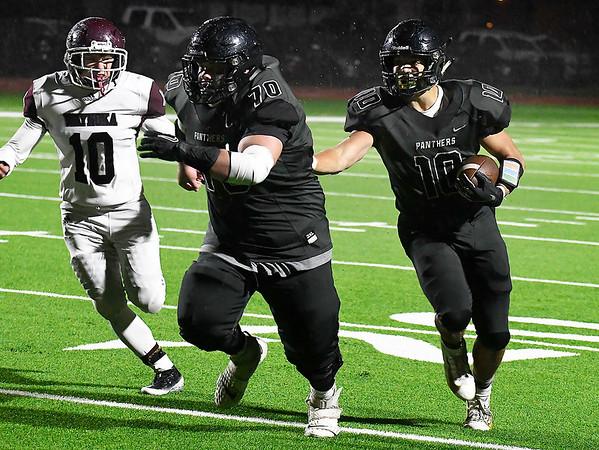 Pond Creek-Hunter's Noah Miller follows Kellen Claflin for an 18 yard touchdown run against Waynoka Thursday, October 24, 2019 at Pond Creek-Hunter High School. (Billy Hefton / Enid News & Eagle)