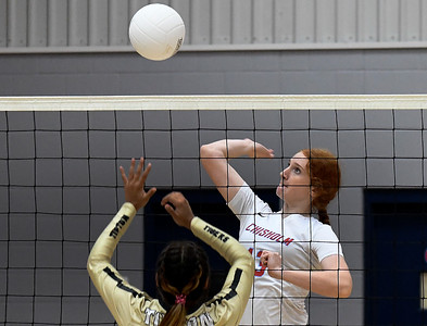 Chisholm's Lydia Peace hits the ball against Tipton's Gabby Rodriguez during a regional tournament Thursday, October 3, 2019 at Chisholm Middle School. (Billy Hefton / Enid News & Eagle)