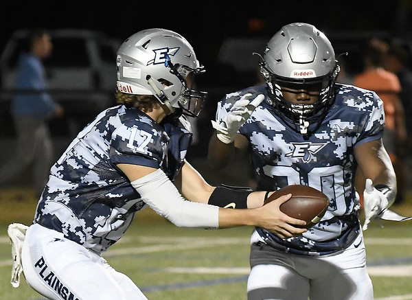 Enid's Maddux Mayberry hands the ball to Trent Mitchell against Norman Friday October 18, 2019 at D. Bruce Selby Stadium in Enid. (Billy Hefton / Enid News & Eagle)
