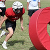 OBA's Jett Cheatham hits the tackling ring during practice Tuesday, October 1, 2019 at Oklahoma Bible Academy. (Billy Hefton / Enid News & Eagle)