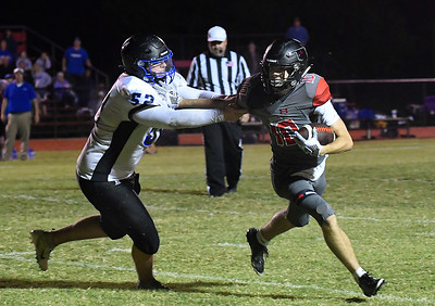 OBA's Jacob Wilson tries to get away from NOAH's Luke Maier Friday, October 4, 2019 at Oklahoma Bible Academy. (Billy Hefton / Enid News & Eagle)