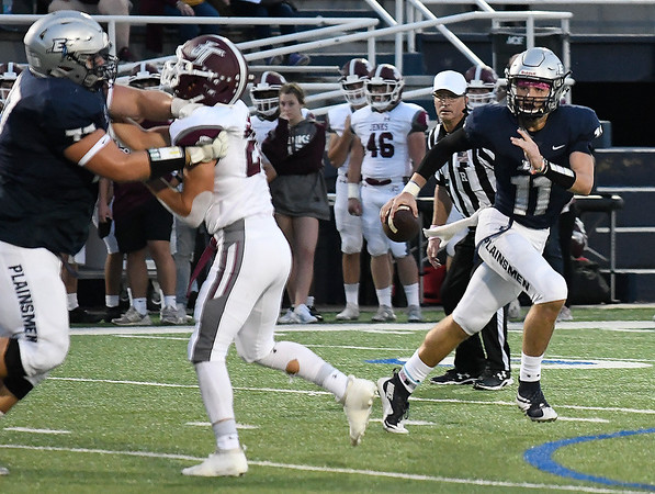 Enid's Blake Priest scrambles out of the pocket against Jenks Friday, October 4, 2019 at D. Bruce Selby Stadium. (Billy Hefton / Enid News & Eagle)