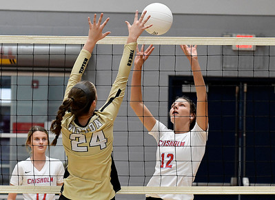 Chisholm's Courtney Peterson knocks the ball over the net against Tipton's Kamryn Roberts during a regional tournament Thursday, October 3, 2019 at Chisholm Middle School. (Billy Hefton / Enid News & Eagle)