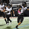 Norman's Max Bass follows Joe Willie around the end against Enid Friday October 18, 2019 at D. Bruce Selby Stadium in Enid. (Billy Hefton / Enid News & Eagle)