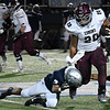 Enid's Jaden Dimaricut goes low to tackle Edmond Memorial's Mason Williams Friday, October 25, 2019 at D. Bruce Selby Stadium. (Billy Hefton / Enid Nws & Eagle)
