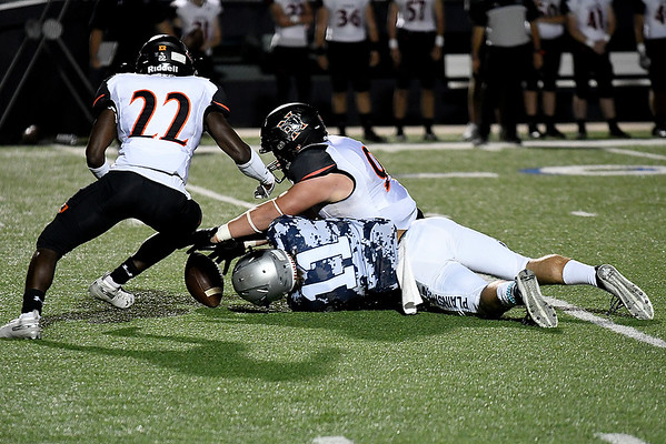 Norman's Braden Woods and Jackson Caldwell go after a loose ball against Enid's Blake Priest Friday October 18, 2019 at D. Bruce Selby Stadium in Enid. (Billy Hefton / Enid News & Eagle)