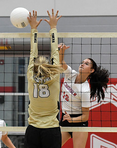 Chisholm's Raylee Savage hits the ball off the hand of Tipton's Brie Elliott during a regional tournament Thursday, October 3, 2019 at Chisholm Middle School. (Billy Hefton / Enid News & Eagle)