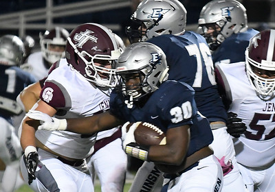 Enid's Trent Mitchell carries the ball against Jenks Friday, October 4, 2019 at D. Bruce Selby Stadium. (Billy Hefton / Enid News & Eagle)