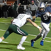 Enid's Tykie Andrews tries to avoid Edmond Santa Fe's Dylan Rodgers Friday October 30, 2020 at D. Bruce Selby Stadium. (Billy Hefton / Enid News & Eagle)