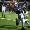 Enid's Maddux Mayberry geta away from Edmond Santa Fe's Tyler Lewis to score a touchdown   Friday October 30, 2020 at D. Bruce Selby Stadium. (Billy Hefton / Enid News & Eagle)