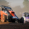 Gil White (left), in his 45g, slides high along the straight away as he and Mike Ramsey, in 24, jockey for position during hot laps at the Enid Speedway Saturday, Sept. 7, 2013. (Staff Photo by BONNIE VCULEK)
