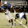 Enid's Marshawn Mills sheds a Bartlesville tackler during a kick-off return at D. Bruce Selby Stadium Friday, Sept. 27, 2013. (Staff Photo by BONNIE VCULEK)