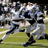 Enid's Devin Pratt (28) and Marshawn Mills (21) force a Bartlesville's Colton Penrod out of bounds during the first half at D. Bruce Selby Stadium Friday, Sept. 27, 2013. (Staff Photo by BONNIE VCULEK)