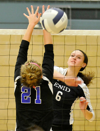 Enid's Chloe Cordell hits the ball pass a Sapulpa defender Monday at Waller Middle School. (Staff Photo by BILLY HEFTON)