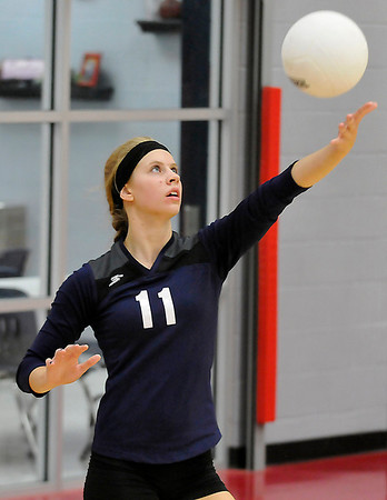 Enid's Shaelyn Vaughn serves against Chisholm Monday at the Chisholm Middle School gym. (Staff Photo by BILLY HEFTON)