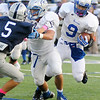 Guthrie's offensive lineman gives Kai Callins extra running room during the Bluejays 36-16 win over the Enid Plainsmen at D. Bruce Selby Stadium in Enid Friday, Sept. 20, 2013. (Staff Photo by BONNIE VCULEK)