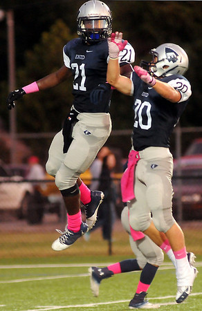 Enid's Marshawn Mills and Sam Clemens celebrate Mills' score for the Plainsmen during the Plainsmen's home game against Guthrie at D. Bruce Selby Stadium Friday, Sept. 20, 2013. (Staff Photo by BONNIE VCULEK)
