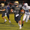 Kingfisher's Landon Nault runs against Hennessey Friday at Kingfisher High School. (Staff Photo by BILLY HEFTON)