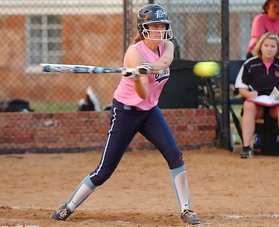 Olivia Andrews connects on a single to right against Owasso Tuesday at Pacer Field. (Staff Photo by BILLY HEFTON)