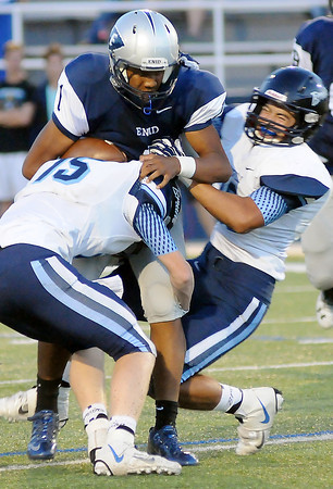 Bartlesville tacklers converge on Enid quarterback, Freddie Lawrence, after a short gain at D. Bruce Selby Stadium Friday, Sept. 27, 2013. (Staff Photo by BONNIE VCULEK)