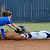 Stillwater's Laikyn Anderson (left) tags Enid's Haven Bay out at second during the bottom of the second inning at Pacer Field in Enid Monday, Sept. 23, 2013. (Photo Courtesy of Enid News & Eagle, Bonnie Vculek)