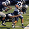 The Enid Plainsmen defense gang tackle a Bartlesville Bruin at D. Bruce Selby Stadium Friday, Sept. 27, 2013. (Staff Photo by BONNIE VCULEK)