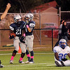 Enid's Marshawn Mills and Tony Salcido celebrate as the referee signals a touchdown near Guthrie's Donovan Jordan at D. Bruce Selby Stadium Friday, Sept. 20, 2013. (Staff Photo by BONNIE VCULEK)