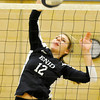 Enid's McKeena James hits the ball against Sapulpa Monday at Waller Middle School. (Staff Photo by BILLY HEFTON)