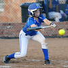 Stillwater's Cailyn Fluty tries to bunt a pitch from Enid's Ally Lewis during a game at Pacer Field in Enid Monday, Sept. 23, 2013. (Photo Courtesy of Enid News & Eagle, Bonnie Vculek)