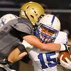 Kingfisher's Jace Sternberger wraps up Hennessey's Steven Lott Friday at Kingfisher High School. (Staff Photo by BILLY HEFTON)