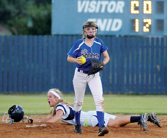 Enid's Haven Bay reacts after Stillwater's Laikyn Anderson tags Bay out at second, ending the second inning at Pacer Field Monday, Sept. 23, 2013. (Photo Courtesy of Enid News & Eagle, Bonnie Vculek)