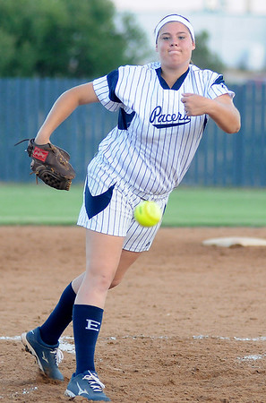Enid's Ally Lewis delivers a strike to a Stillwater Lady Pioneer at Pacer Field Monday, Sept. 23, 2013. (Staff Photo by BONNIE VCULEK)