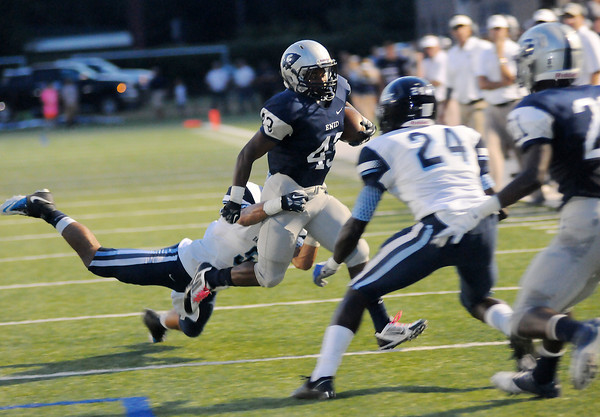 Enid's Raheem Mitchell (43) angles toward the end zone before he is brought down from behind by Bartlesville's # 5 at D. Bruce Selby Stadium Friday, Sept. 27, 2013. (Staff Photo by BONNIE VCULEK)
