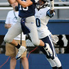 Enid's Aaron Beagle intercepts a pass intended for a Bartlesville Bruin during homecoming festivities at D. Bruce Selby Stadium Friday, Sept. 27, 2013. (Staff Photo by BONNIE VCULEK)