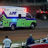 Racing officials and Life EMS assist at the fire in Dewayne Grimm's pure stock at Enid Speedway Saturday, Sept. 7, 2013. Grimm was not injured. (Staff Photo by BONNIE VCULEK)