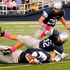 Enid Plainsmen recover a Guthrie fumble during the first half at D. Bruce Selby Stadium Friday, Sept. 20, 2013. (Staff Photo by BONNIE VCULEK)