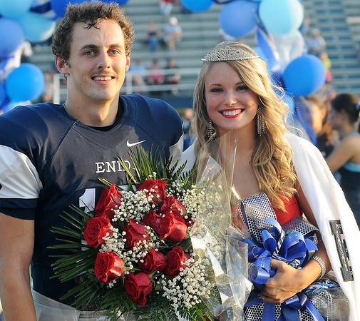 Aaron Beagle and MacKenzie Moulton (from left) were named the Enid High School Plainsmen football homecoming king and queen at D. Bruce Selby Stadium Friday, Sept. 27, 2013. (Staff Photo by BONNIE VCULEK)