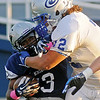 Guthrie's Trevor Blassingame (72) tackles Enid's Raheem Mitchell behind the line of scrimmage during the first quarter at D. Bruce Selby Stadium Friday, Sept. 20, 2013. (Staff Photo by BONNIE VCULEK)