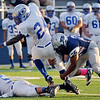 Enid's Isaiah Singleton makes a single leg tackle on Guthrie's Donovan Jordan during the Bluejays' 36-16 win over the Plainsmen at D. Bruce Selby Stadium Friday, Sept. 20, 2013. (Staff Photo by BONNIE VCULEK)
