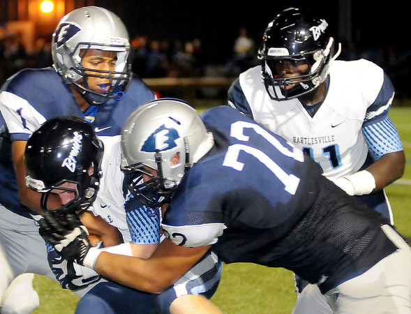Enid's Freddie Lawrence (1) and Estevan Arana (72) save a touchdown as they tackle a Bartlesville Bruin following an interception at D. Bruce Selby Stadium Friday, Sept. 27, 2013. (Staff Photo by BONNIE VCULEK)