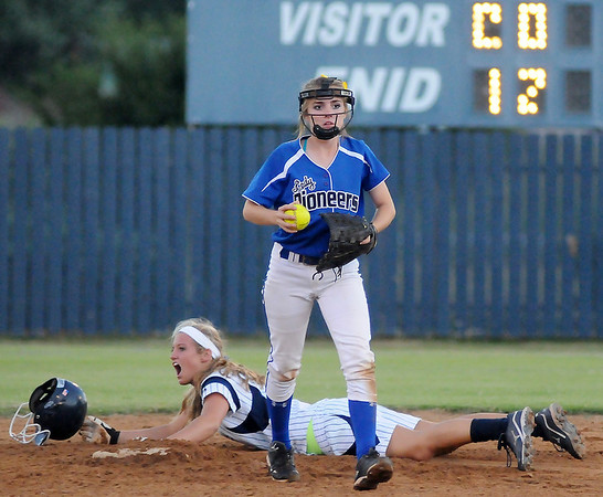 Enid's Haven Bay reacts after Stillwater's Laikyn Anderson gets the tag at second during the bottom of the second inning at Pacer Field Monday, Sept. 23, 2013. (Staff Photo by BONNIE VCULEK)